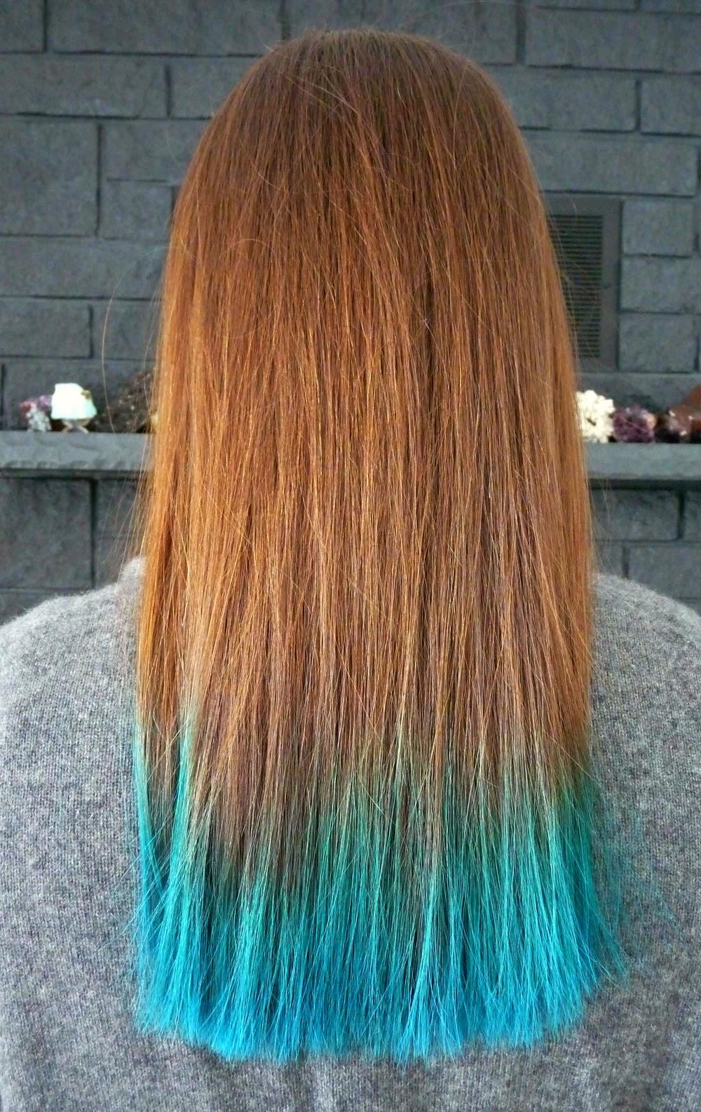 Brunette hair dip dyed aqua