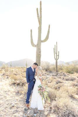 bride and groom portraits with cactus