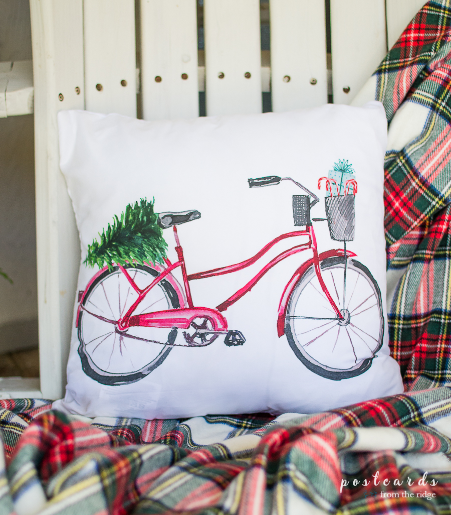 fun red bicycle Christmas pillow cover and plaid throw blanket