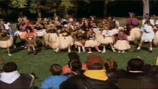 Kids rehearse a large group African dance in the park. sesame street zoe's dance moves