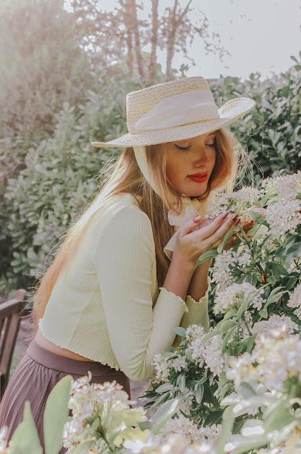 english rose fashion scene smelling flowers
