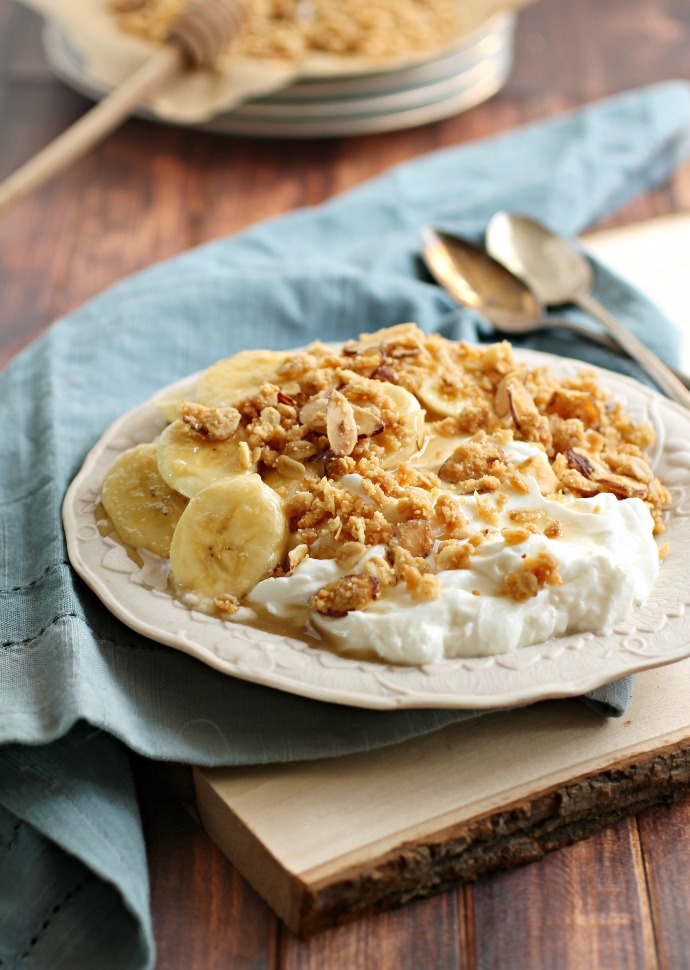 Recipe for a crumb topping made with almond meal, oats and honey, served over yogurt and honeyed bananas.