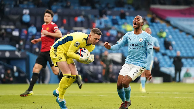 city forward Raheem Sterling misses a chance against Manchester united