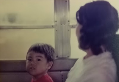 Mom and me on a bus, during my preschool years