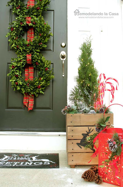 red ribbon, planters, pines, green door, luminaries, candy cane
