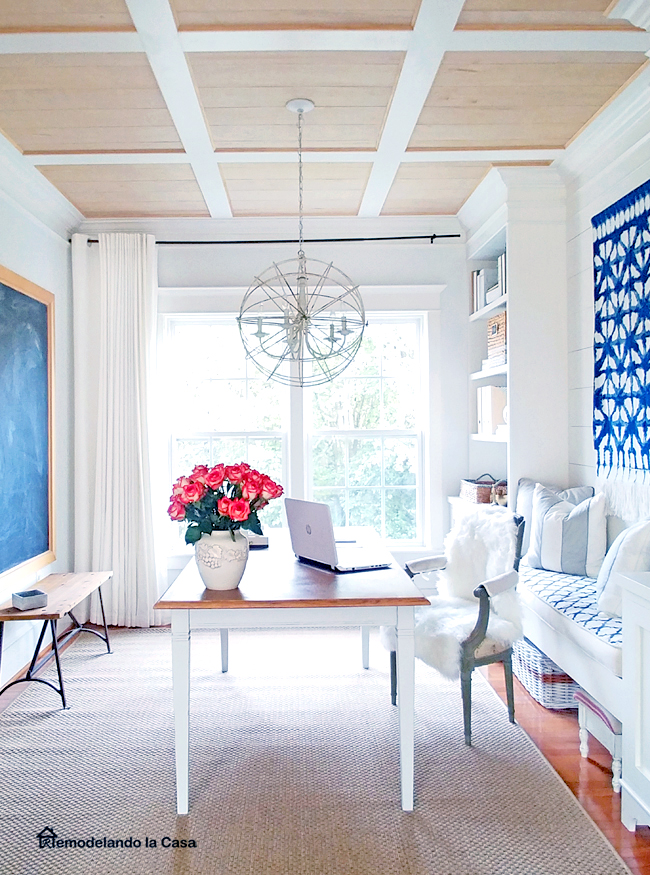 coffered ceiling and farmhouse dining table in office with shibori wall art