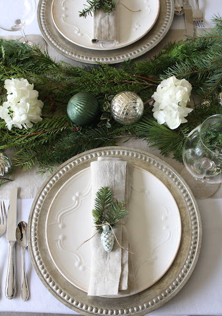 gorgeous holiday tablescape with greens white hydrangeas ornaments gorgeous christmas