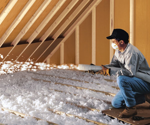 insulation contractor adding attic insulation