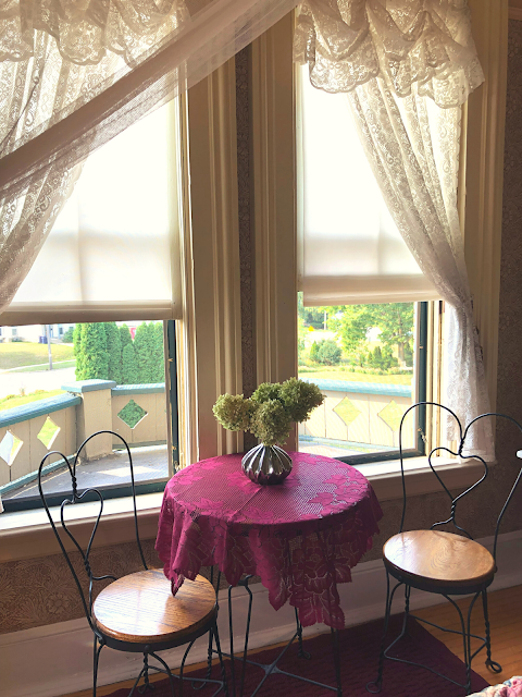 Whisps of lace and a sweetheart table added romance to our suite at Guardian Angel Bed and Breakfast in Janesville, WI.