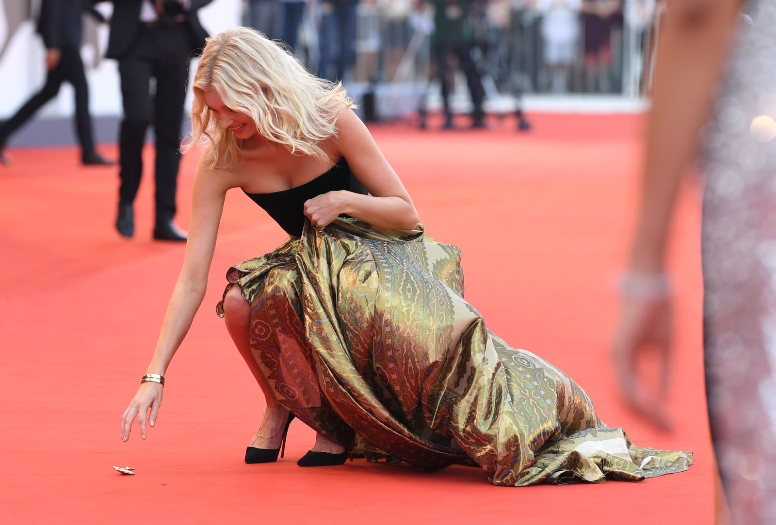 Elsa Hosk scrambles for dropped earring at the 'Marriage Story' 2019 Venice Film Festival premiere