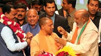 UP CM Yogi Adityanath allocates portfolios, keeps Home