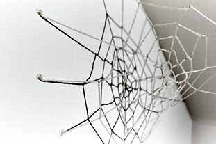 picture hanging solutions - spider's web made of wool and string