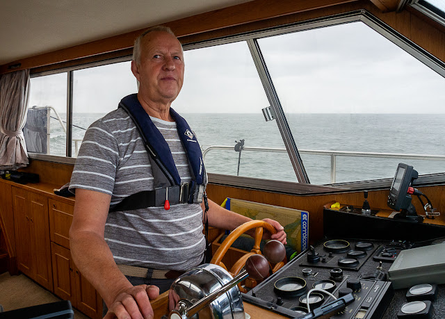 Photo of Phil at the helm of Ravensdale on the way to Allonby Bay