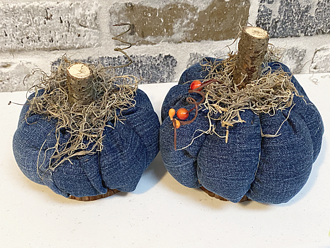 recycled denim pumpkins on wooden bases