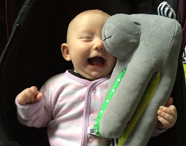 Cuddling a Whisbear which makes white noise to help soothe babies to sleep