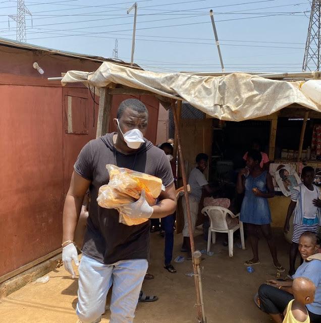 Coronavirus - John Dumelo Distributes Bread and Satchet Water in His Community