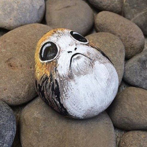 painted stone painted to look like a mini porg
