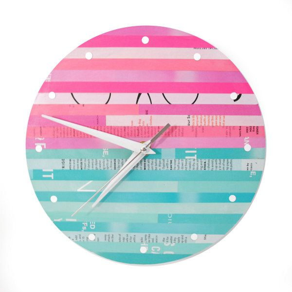 clock face made of color coordinated magazine page strips