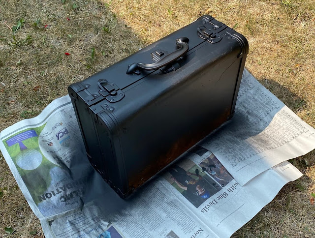 Photo of a suitcase that was painted black