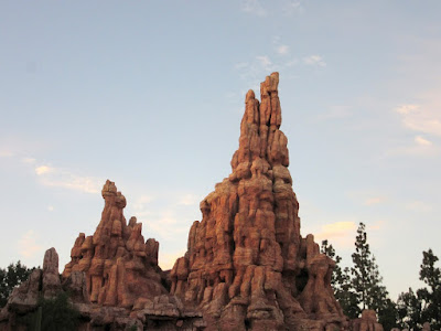 Big Thunder Mountain Railroad in Disneyland at sunset.