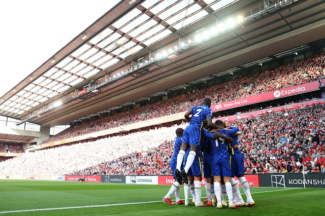 Chelsea players celebrate a goal against Liverpool at Anfield