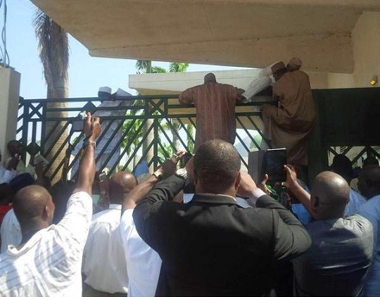 apc lawmakers climbing fence