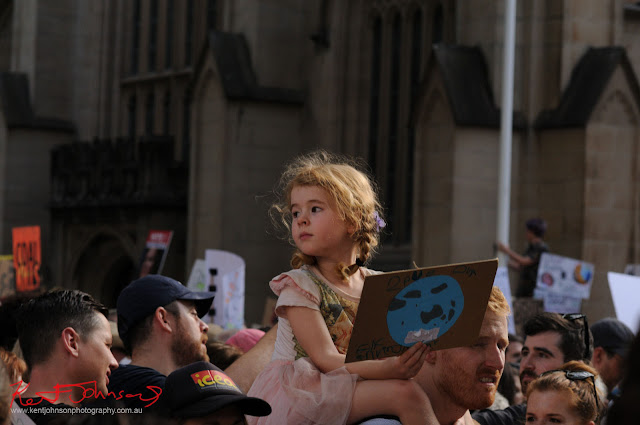 Sydney Climate Rally - it is all about saving the planet for future generations - Girl on parents shoulder holding save the planet sign.