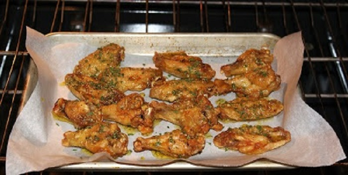 These are baked Italian wings with a garlic parmesan buttery coating after baked on top garnished with parsley. They taste like fried wings but they are baked not fried.
