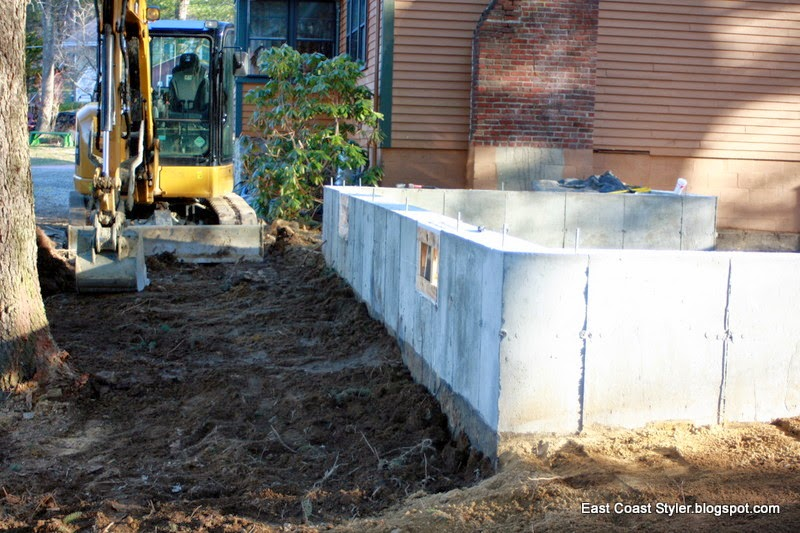 1,000 sq. ft. home construction addition CAT excavator