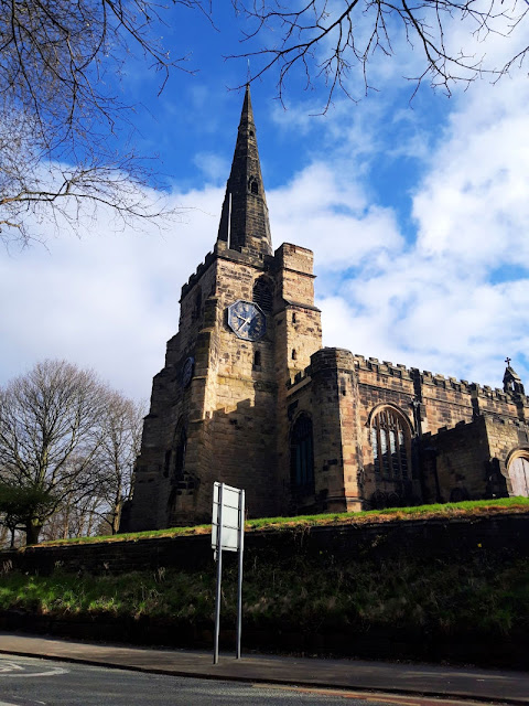 Image shows St Oswald's Church, Winwick, in morning sunlight