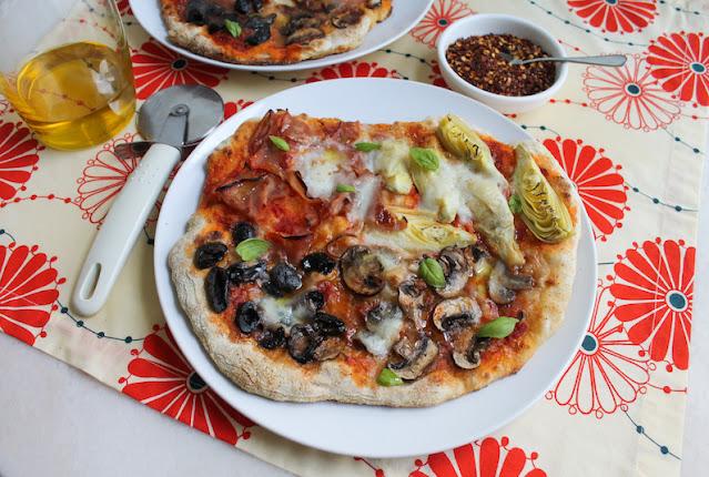 Food Lust People Love: Artichokes, tomato sauce, basil, mushrooms, ham and olives represent all four seasons in this Quattro Stagioni Sourdough Pizza, with fresh mozzarella.