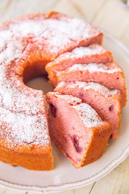 Strawberry Pound Cake - THE BEST strawberry pound cake I've ever eaten! Packed FULL of delicious strawberry flavor! Flour, baking powder, salt, eggs, milk, vanilla, butter, sugar, strawberry jello, frozen strawberries in sugar. Top with whipped cream, vanilla ice cream and fresh strawberries. Can freeze for a quick dessert later. Great for potlucks! #strawberry #poundcake #dessert #cake
