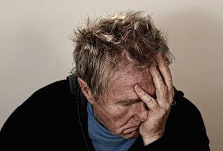 A person having a headache.