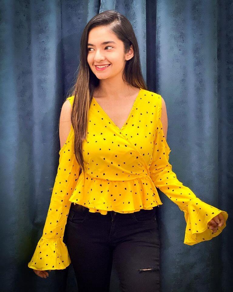 anushka sen on yellow dress.