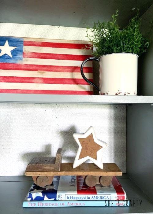Last minute 4th of july decorating ideas -gray cabinet shelves vignette- patriotic books, stars