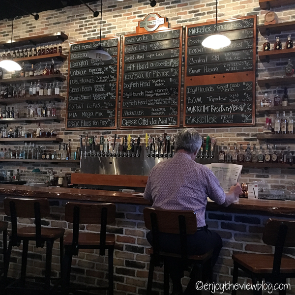 bar with beer menu on the wall
