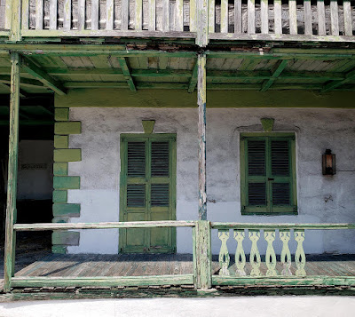 close up of aged colonial style house