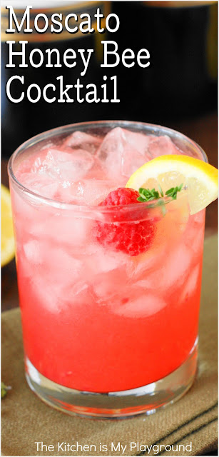Moscato Honey Bee Cocktail ~ Grab a jar of honey & some fresh raspberries to whip up this delicious wine cocktail! It's just perfect for Easter brunch, Mother's Day lunch, a bridal shower, or everyday sipping.  www.thekitchenismyplayground.com