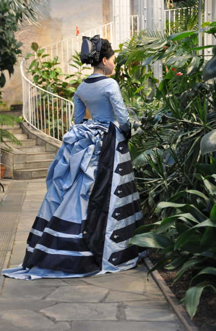 Historically accurate Victorian afternoon dress in two tones of blue silk fabric. Victorian costumes and clothing for women.