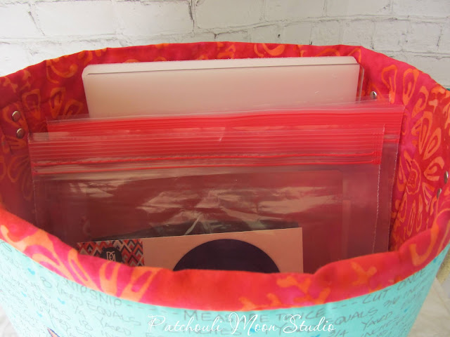 Inside look at fabric container holding plastic bags with cutting dies inside bags
