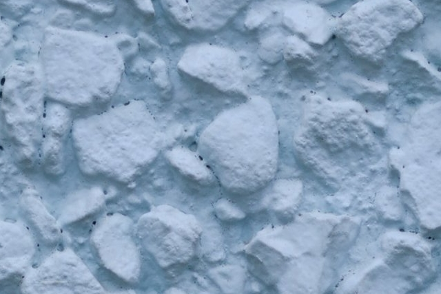 Smooth blue painted stone stucco wall texture at 100%