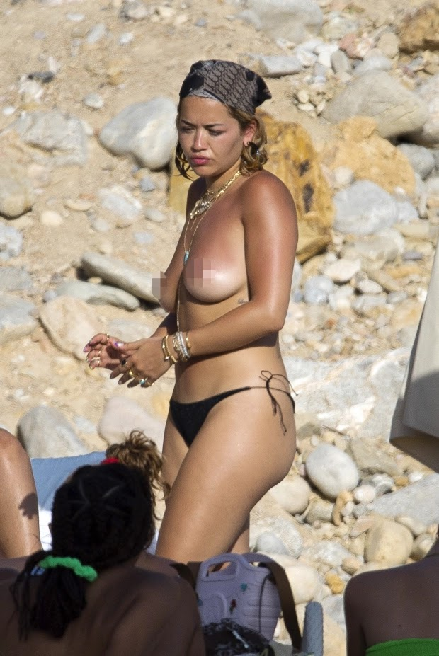 Rita Ora goes topless as she sunbathes with her boyfriend