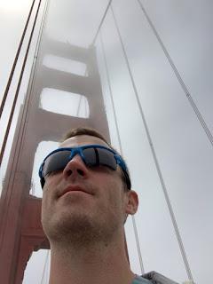 Farmer man in blue sunglasses on the golden gate bridge with fog behind