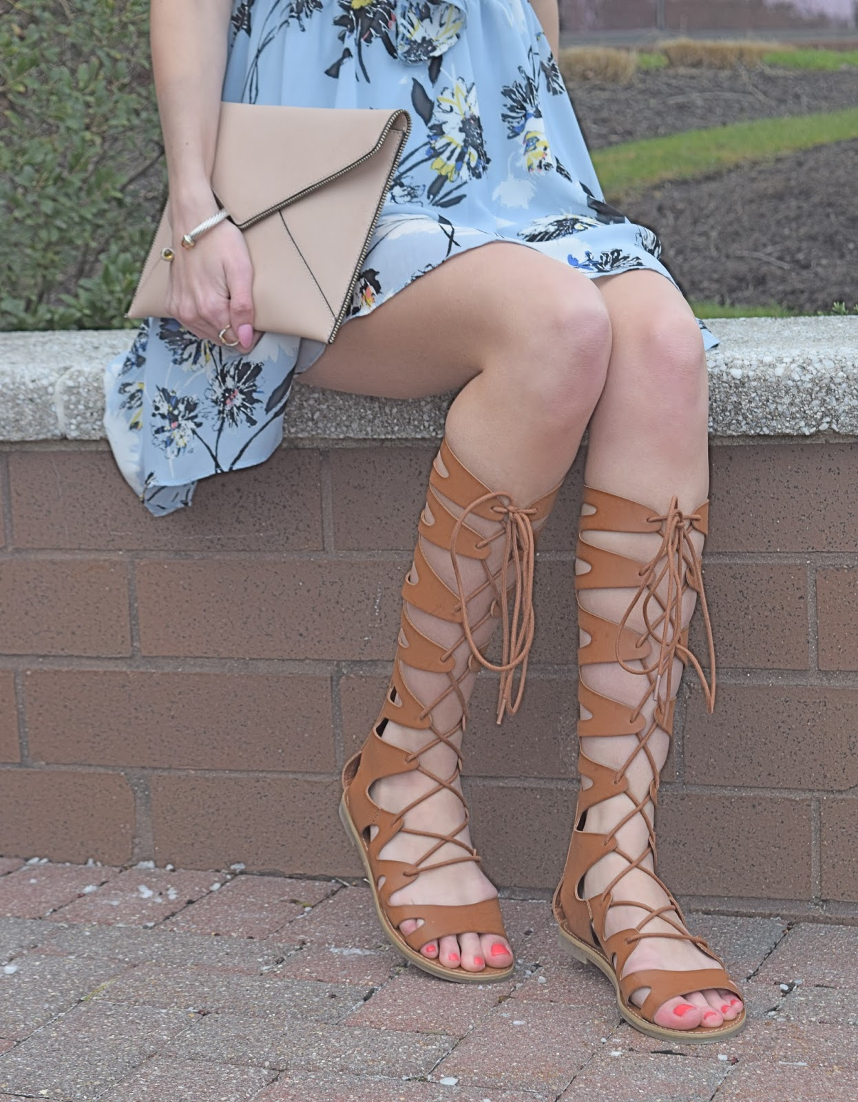 Wearing blue floral tie front dress, Wearing Women's Target Lizzy Gladiator Sandals, Rebecca Minkoff Pink Leo envelope Clutch