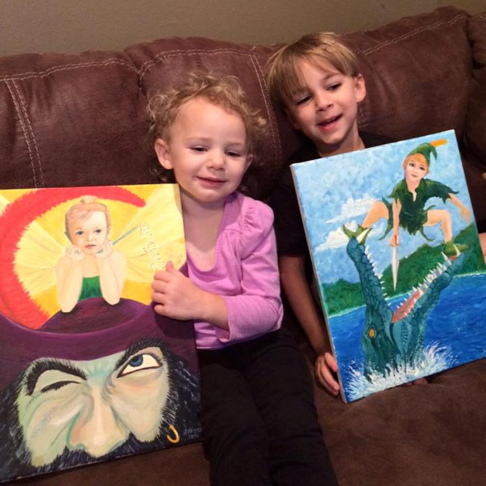 Karlie Rose and Gabriel receiving their painted portraits
