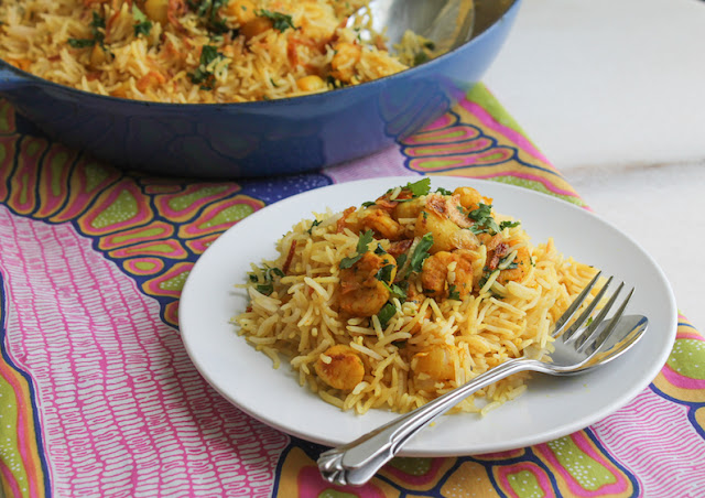 "Food Lust People Love: This Bay Scallop Shrimp Biryani is a fragrant dish of well-seasoned seafood quickly seared till golden then mixed with long-grained basmati rice. It's one of our favorite one-pot meals! I've adapted this recipe from the shrimp biryani in ""At Home with Madhur Jaffrey."""