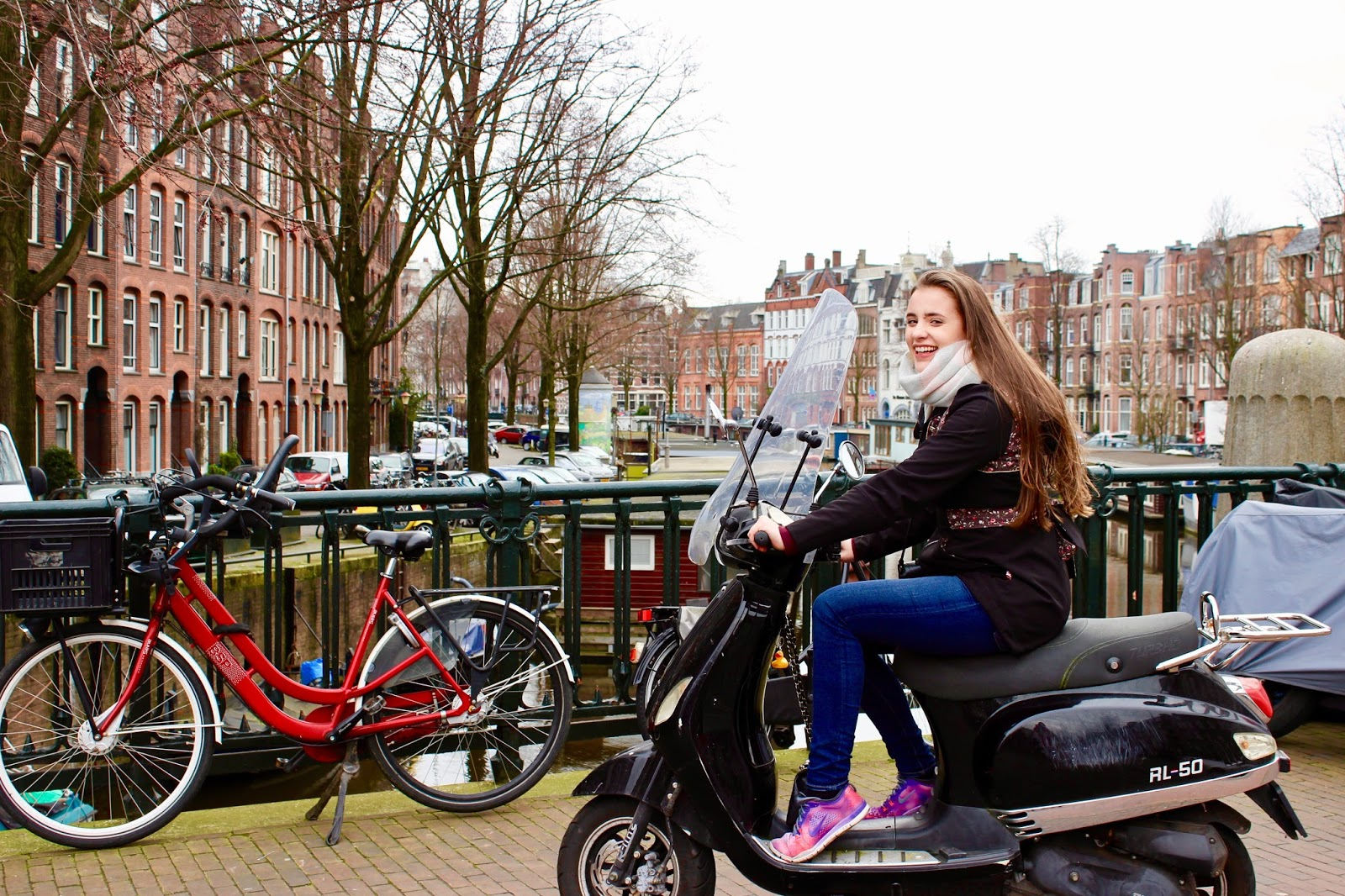 Scooter Amsterdam Canals