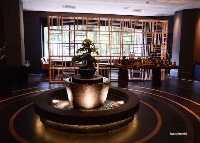 Beautiful decor of Sasagawa, complete with a bonsai tree in the middle of the restaurant