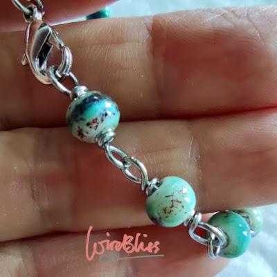 Wire wrapped ceramic beads bracelet on my hand