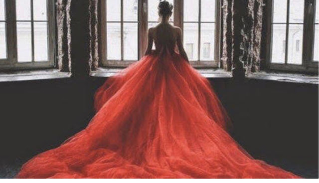 women in red gown dreaming